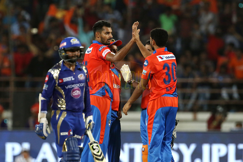 Gujarat Lions players celebrates the wicket of Nitish Rana of the Mumbai Indians during match 35 of the Vivo 2017 Indian Premier League between the Gujarat Lions and the Mumbai Indians  held at the Saurashtra Cricket Association Stadium in Rajkot, India on the 29th April 2017<br /> <br /> Photo by Vipin Pawar - Sportzpics - IPL