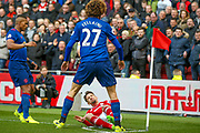 Manchester United midfielder Marouane Fellaini (27) bundles Middlesbrough midfielder Gaston Ramirez (21)  to the floor during the Premier League match between Middlesbrough and Manchester United at the Riverside Stadium, Middlesbrough, England on 19 March 2017. Photo by Simon Davies.