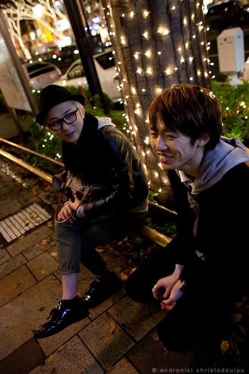 Stylish Japanese men on Omotesando-dori street in Harajuku.