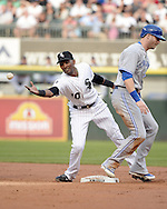 CHICAGO - AUGUST 16:  Alexei Ramirez of the Chicago White Sox fields against the Toronto Blue Jays on August 16, 2014 at U.S. Cellular Field in Chicago, Illinois.   (Photo by Ron Vesely)
