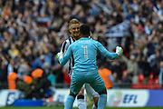 Millwall defender Byron Webster (17) celebrates with Millwall goalkeeper Jordan Archer (1) after the EFL Sky Bet League 1 play off final match between Bradford City and Millwall at Wembley Stadium, London, England on 20 May 2017. Photo by Martin Cole.