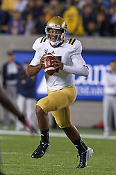 BERKELEY, CA - OCTOBER 06: Quarterback Brett Hundley #17 of the UCLA Bruins scrambles out of the pocket against the California Golden Bears during the first quarter at California Memorial Stadium on October 6, 2012 in Berkeley, California. (Photo by Jason O. Watson/Getty Images) *** Local Caption *** Brett Hundley