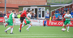 NEWTOWN, WALES - Saturday, May 2, 2015: Newtown's Matty Owen shoots against The New Saints during the FAW Welsh Cup final match at Latham Park. (Pic by Ian Cook/Propaganda)