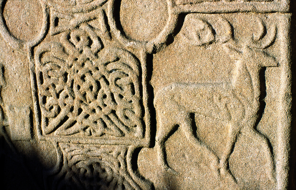 Detail of Eassie carved stone Celtic Pictish Christian cross slab near Coupar Angus, Tayside, Scotland. Knotwork and deer stag