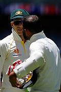 18th December 2018, Optus Stadium, Perth, Australia; International Test Series Cricket, Australia versus India, second test, day 5; Tim Paine of Australia talks with Mohammed Shami of Indian after Australia won the second Test