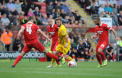 Matt Taylor of Bristol Rovers is challenged by Connor Essam of Leyton Orient - Mandatory byline: Neil Brookman/JMP - 07966386802 - 29/08/2015 - FOOTBALL - Matchroom Stadium -Leyton,England - Leyton Orient v Bristol Rovers - Sky Bet League Two