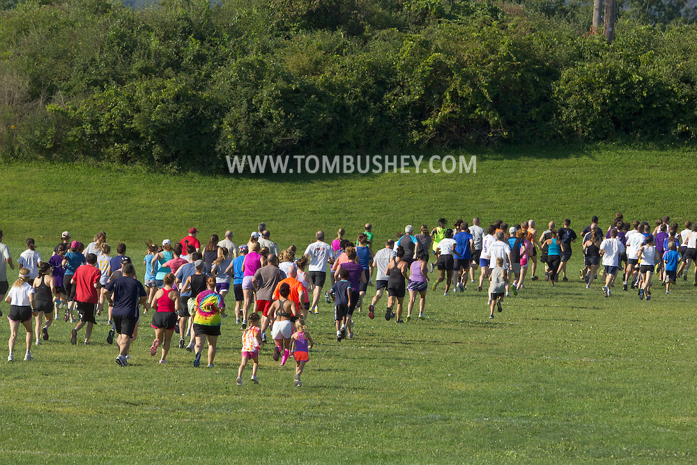 Central Valley, New York - Central Valley, New York - Runners take off at the start ofthe Woodbury Country Ramble race on Aug. 26, 2012.