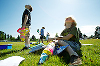 Jameson Wasson, 8, right, and Isaac Lunnen, 9, look skyward at a rocket that was launched by one of their science fair classmates.
