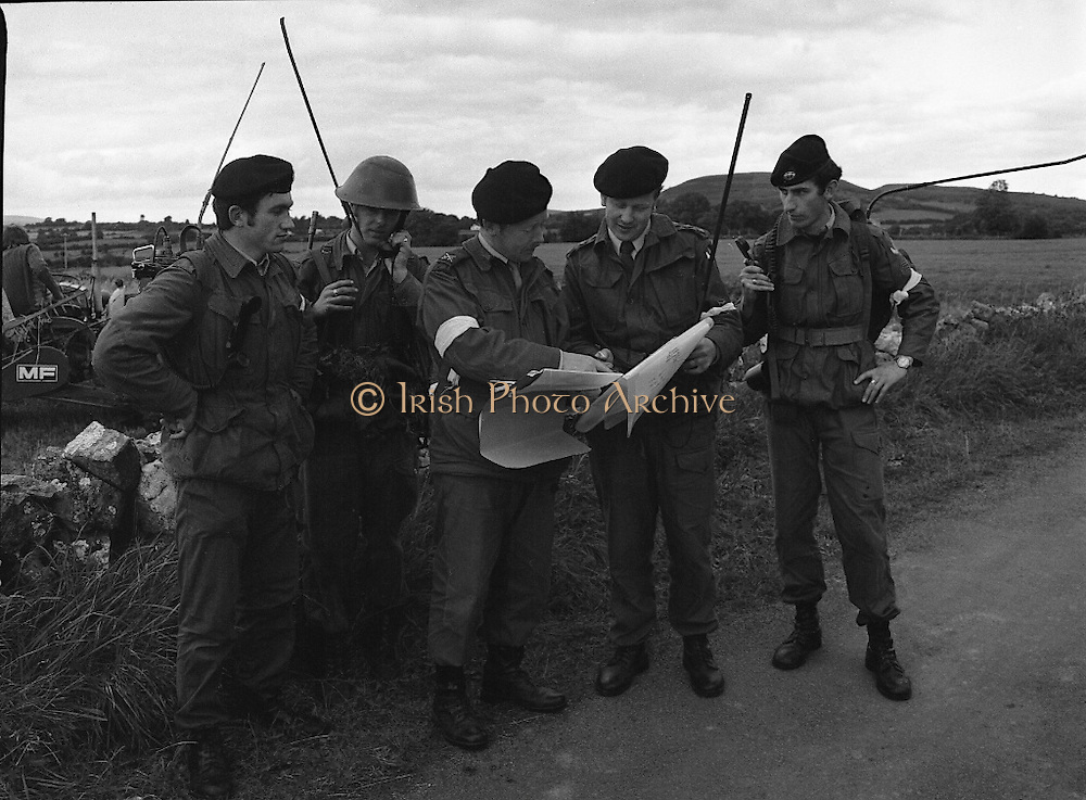 "Army Exercises In Co Sligo.   (L37).<br /> 1977.<br /> 05.09.1977.<br /> 09.05.1977.<br /> 5th September 1977.<br /> The Army Reserve Brigade, which is made up of regular units from the Southern Command, are conducting a series of conventional military exercises in counties Mayo and Sligo from the 5th to the 9th September. Approximately 1,500 men and 250 vehicles are involved. The exercise was codenamed ""Humbert"" after an ill fated expedition by French troops into Ireland on 23rd August 1798. 1,100 French troops with Irish support took on the incumbent English forces. After some initial success they were defeated at Ballinamuk on 8th Sept 1798 by the army of Cornwallis.<br /> <br /> Pictured at the military exercises were (L-R) Corp Tim Flaherty, Pte J Murphy,Capt Martin Coughlan, Comdt E O'Hanlon and Capt Brendan Forde."