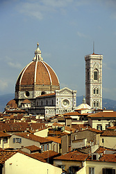Florence, Italy: the Dome and Campanile of the Duomo dominate the city's red-roofed skyline.  the Dome was by Brunelleschi (1463), the largest ever built without scaffolding.