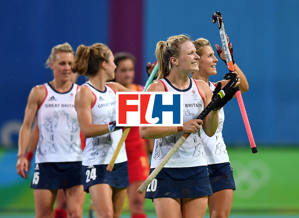 CORRECTION - Britain's Hollie Webb (2nd R) leave the pitch after the women's quarterfinal field hockey Britain vs Spain match of the Rio 2016 Olympics Games at the Olympic Hockey Centre in Rio de Janeiro on August 15, 2016. / AFP / MANAN VATSYAYANA / The erroneous mention[s] appearing in the metadata of this photo by MANAN VATSYAYANA has been modified in AFP systems in the following manner: [Britain's Hollie Webb (2nd R)] instead of [Britain's Shona McCallin and Britain's Alex Danson (C R)]. Please immediately remove the erroneous mention[s] from all your online services and delete it (them) from your servers. If you have been authorized by AFP to distribute it (them) to third parties, please ensure that the same actions are carried out by them. Failure to promptly comply with these instructions will entail liability on your part for any continued or post notification usage. Therefore we thank you very much for all your attention and prompt action. We are sorry for the inconvenience this notification may cause and remain at your disposal for any further information you may require.        (Photo credit should read MANAN VATSYAYANA/AFP/Getty Images)