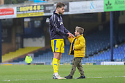 AFC Wimbledon midfielder Anthony Wordsworth (40) with Southend United fan after final whistle during the EFL Sky Bet League 1 match between Southend United and AFC Wimbledon at Roots Hall, Southend, England on 16 March 2019.