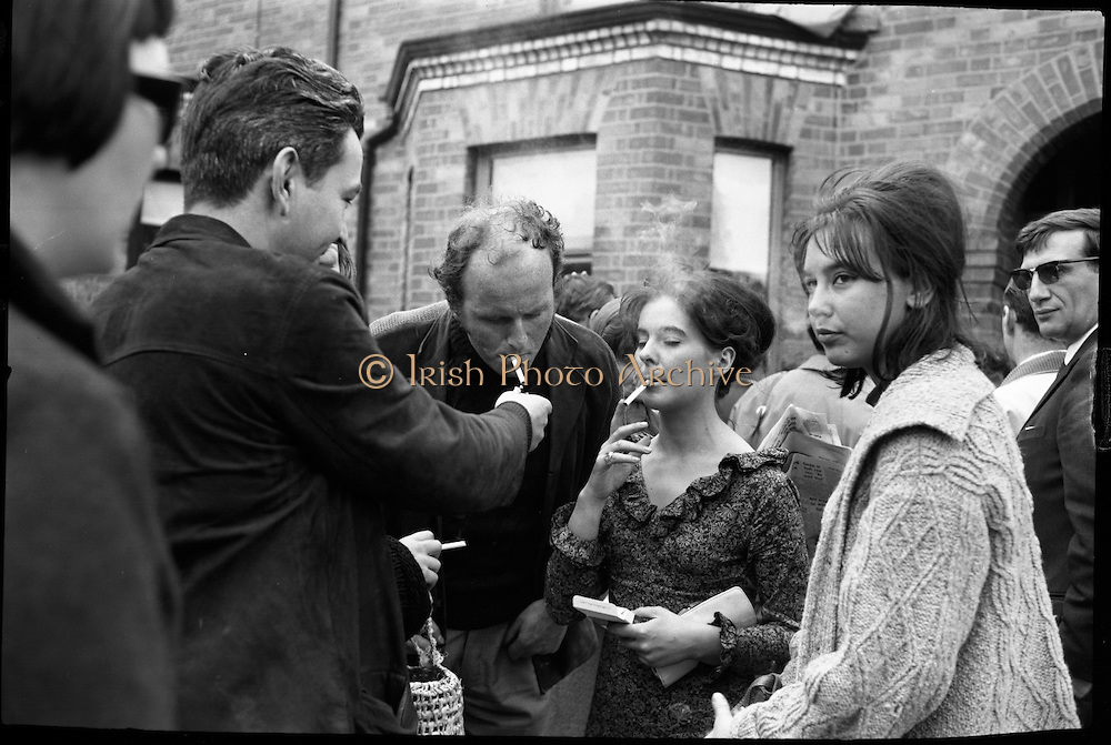 "Bloomsday. Plaque unveiled at James Joyce's birthplace, 41 Brighton Square. Actresses Caroline Fitzgerald, Fionnuala O'Shannon and Brita Strong, all starring in ""Bloomsday"" at the Gate Theatre, share a smoke with actors Patrick Bedford and Dick Butterworth..16.06.1964"