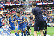 Lyle Taylor is soaked with Champagne. AFC Wimbledon promotion to League One, after beating Plymouth Argyle Football Club 2-0 during the Sky Bet League 2 play off final match between AFC Wimbledon and Plymouth Argyle at Wembley Stadium, London, England on 30 May 2016. Photo by Stuart Butcher.