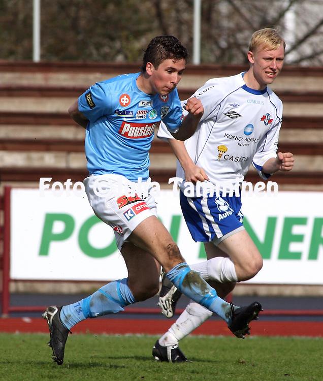 09.05.2009, Pori, Finland..Ykk?nen 2009.FC PoPa - FC H?meenlinna.Kari-Pekka Koivunen (PoPa) v Mikko Kalervo (FC Hml).©Juha Tamminen.