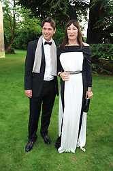 DOUGRAY SCOTT and ANJELICA HOUSTON at the Raisa Gorbachev Foundation Party held at Stud House, Hampton Court Palace on 5th June 2010.  The night is in aid of the Raisa Gorbachev Foundation, an international fund fighting child cancer.