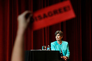 "An audience member holds up a ""DISAGREE"" sign after Sen. Joni Ernst explained why she voted for education secretary Betsy DeVosFriday, March 17, 2017, during her Polk Count town hall meeting in Sheslow Auditorium at Drake Universtiy."
