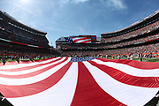 Members of the United States Army unfurl an American flag on the field in this general view photograph taken from the end zone under the goal post before the Cleveland Browns 2017 NFL week 4 regular season football game against the against the Cincinnati Bengals, Sunday, Oct. 1, 2017 in Cleveland. The Bengals won the game 31-7. (©Paul Anthony Spinelli)