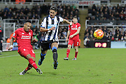 Liverpool's Defender Nathaniel Clyne crosses the ball challenged by Newcastle United's Striker Ayoze Perez during the Barclays Premier League match between Newcastle United and Liverpool at St. James's Park, Newcastle, England on 6 December 2015. Photo by George Ledger.