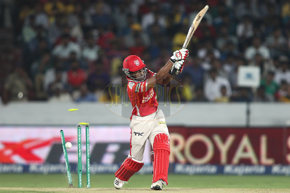 Wriddhiman Saha of the Kings XI Punjab is bowled by Ashish Nehra of the Chennai Super Kings during the second semi final match of the Oppo Champions League Twenty20 between the Kings XI Punjab and the Chennai Superkings held at the Rajiv Gandhi Cricket Stadium, Hyderabad, India on the 2nd October 2014<br /> <br /> Photo by:  Shaun Roy / Sportzpics/ CLT20<br /> <br /> <br /> Image use is subject to the terms and conditions as laid out by the BCCI/ CLT20.  The terms and conditions can be downloaded here:<br /> <br /> http://sportzpics.photoshelter.com/gallery/CLT20-Image-Terms-and-Conditions-2014/G0000IfNJn535VPU/C0000QhhKadWcjYs