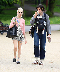 Peaches Geldof, fiancé Thomas Cohen, their baby boy Astala and dog Parpy out in a London park. Peaches wearing a pink cardigan and a short black & white pattern dress took some pictures of the swans before grabing a bite to eat. UK. 13/06/2012<br />BYLINE MUST READ : JAMESY/GOTCHA IMAGES<br /><br />Copyright by © Gotcha Images Ltd. All rights reserved.<br />Usage of this image is conditional upon the acceptance <br />of Gotcha Images Ltd, terms and conditions available at<br />www.gotchaimages.com