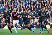 Liverpool forward Roberto Firmino (9) Liverpool defender Virgil van Dijk (4) Burnley forward Ashley Barnes (10) and Liverpool midfielder Fabinho (3) await the ball coming over  during the Premier League match between Burnley and Liverpool at Turf Moor, Burnley, England on 31 August 2019.