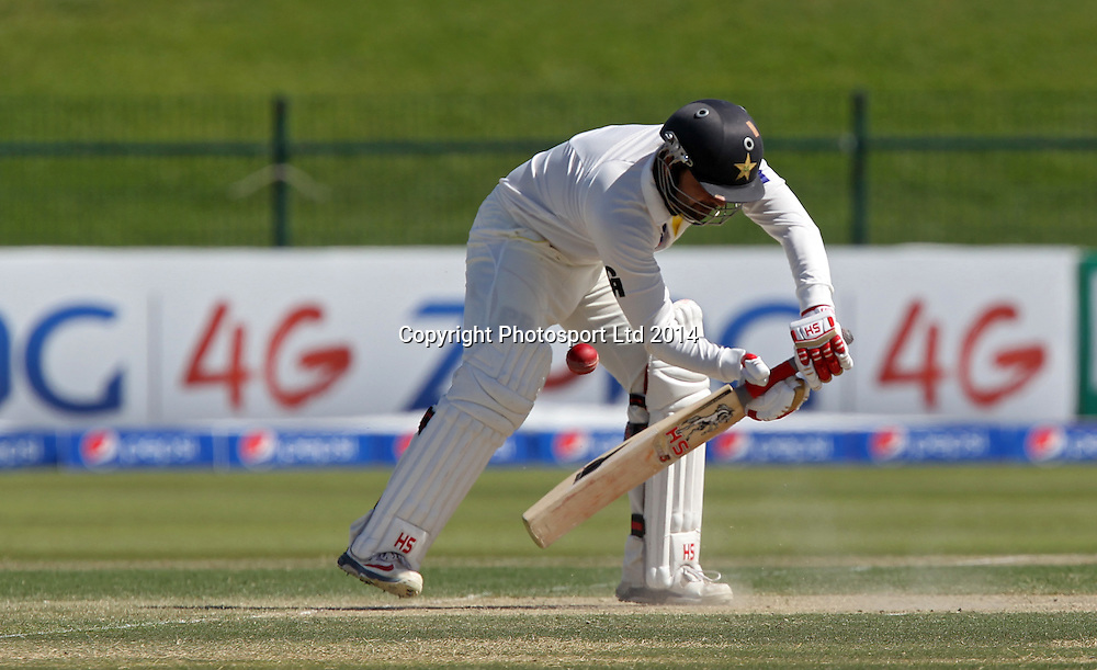 Pakistan vs New Zealand, 10 November 2014 <br /> Ahmed Shehzad plays a shot against New Zealand on the second day of First Test in Abu Dhabi