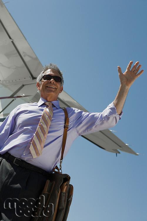 Senior businessman outside of private jet.