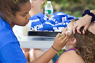 Middletown, New York - Face painting was available at the YMCA Community Fun Day Car Show at the Middletown YMCA on June 2, 2013. The YMCA of Middletown hosted the show in partnership with the Tri-States Car Club and Elks Lodge 1097. ©Tom Bushey / The Image Works