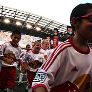 Youngsters run back to the grandstand after escorting the players onto the pitch before the New York Red Bulls Vs San Jose Earthquakes, Major League Soccer regular season match at Red Bull Arena, Harrison, New Jersey. USA. 19th July 2014. Photo Tim Clayton
