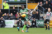 Karleigh Osborne of AFC Wimbledon and Jonathan Stead of Notts County tussle during the Sky Bet League 2 match between Notts County and AFC Wimbledon at Meadow Lane, Nottingham, England on 23 January 2016. Photo by Stuart Butcher.