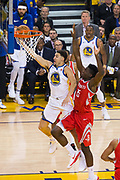 Golden State Warriors guard Klay Thompson (11) takes the ball to the basket against the Houston Rockets during Game 3 of the Western Conference Finals at Oracle Arena in Oakland, Calif., on May 20, 2018. (Stan Olszewski/Special to S.F. Examiner)