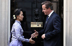 © Licenced to London News Pictures. 30/10/2009. London. UK.  <br /> Prime Minister David Cameron is pictured meeting Burmese political leader Aung San Suu Kyi outside number ten Downing Street in London, October 21st 2013.<br /> Photo Credit: Susannah Ireland