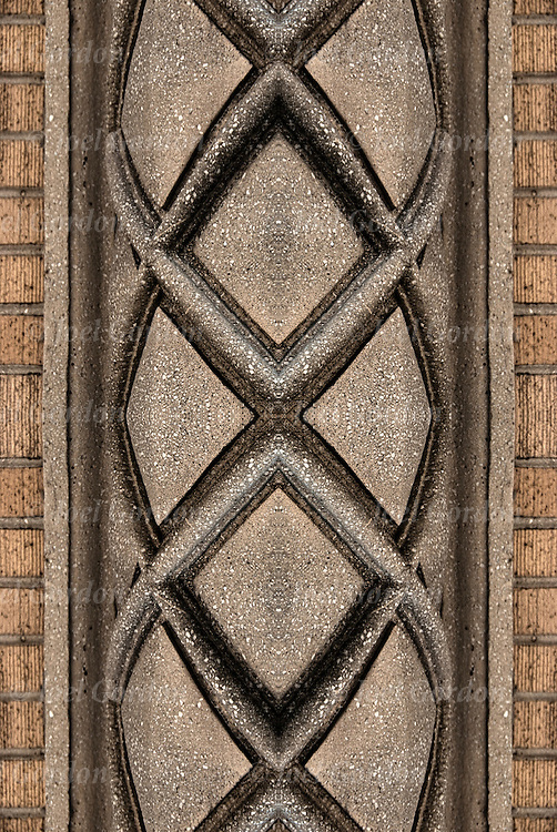 Illusion altered and manipulate image repeating  decorative patterns and design of columns or pillars on side of door entrance of nineteen century  building in Atlantic City, NJ