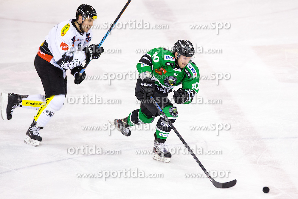 22.02.2015, Hala Tivoli, Ljubljana, SLO, EBEL, HDD Telemach Olimpija Ljubljana vs Dornbirner EC, 6. Qualification Round, in picture Tom Zanoski (HDD Telemach Olimpija, #10) vs Jonathan D'Aversa (Dornbirner EC, #6) during the Erste Bank Icehockey League 6. Qualification Round between HDD Telemach Olimpija Ljubljana and Dornbirner EC at the Hala Tivoli, Ljubljana, Slovenia on 2015/02/22. Photo by Matic Klansek Velej / Sportida
