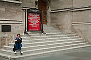 I was crossing 53rd Street at 5th avenue at about ten to two, when I noticed a young woman sitting on the steps of St. Thomas Church.  She was withdrawn from her surroundings and what amazed me was that in a crowded city like New York she was totally alone and not a single person invaded her space for a good two minutes, and on 5th Avenue no less.