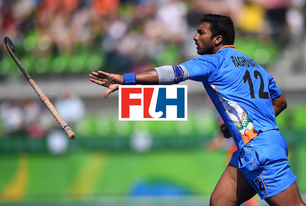 India's Raghunath Vokkaliga celebrates scoring a goal during the men's field hockey Netherland's vs India match of the Rio 2016 Olympics Games at the Olympic Hockey Centre in Rio de Janeiro on August, 11 2016. / AFP / MANAN VATSYAYANA        (Photo credit should read MANAN VATSYAYANA/AFP/Getty Images)