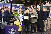 Jillian Percella and Karine Salzmann, both of Longines, present Conquest Classic timepieces to jockey Javier Castellano, owner Kiki Courtelis, left, and trainer Todd Pletcher, right, after their horse Stopchargingmaria won the  Longines Breeders' Cup Distaff, Friday, Oct. 30, 2015 at Keeneland Racecourse in Lexington, KY.  Longines, the Swiss watch manufacturer known for its elegant timepieces, is the Official Watch and Timekeeper of the Breeders' Cup World Championships and the Triple Crown. (Photo by Diane Bondareff/Invsion for Longines/AP Images)
