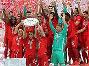 The whole FcBAYERN team celebrates with the trophy, Arjen ROBBEN, RAFINHA, Franck RIBERY, Manuel NEUER, 4 Niklas S&lsaquo;LE, Suele, 5 Mats HUMMELS, 6 Thiago Alc&middot;ntara, Alcantara, 9 Robert Lewandowski, 18 Leon GORETZKA, 22 Serge GNABRY, 25 Thomas M&cedil;ller, Mueller, 27 David Alaba, 29 Kingsley COMAN, 32 Joshua Kimmich, 35 Renato SANCHES,<br /> MUNICH, 18. MAY 2019,  Fc BAYERN vs Eintracht FRANKFURT, 5:1 - Bundesliga Football Match, <br /> FcBayern Muenchen vs Eintracht FRANKFURT Bundesliga match at Allianz Arena on 18.05.2019, DFL REGULATIONS PROHIBIT ANY USE OF PHOTOGRAPHS AS IMAGE SEQUENCES AND/OR QUASI-VIDEO - fee liable image, <br /> copyright &copy; ATP / Arthur THILL