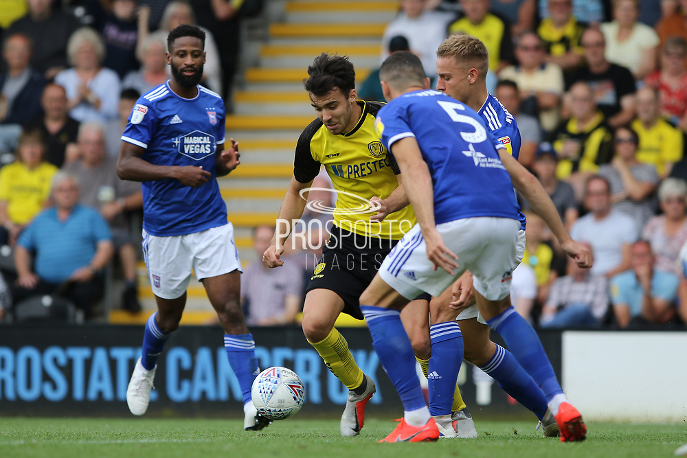 Burton Albion midfielder Scott Fraser on the ball as Ipswich players challenge during the EFL Sky Bet League 1 match between Burton Albion and Ipswich Town at the Pirelli Stadium, Burton upon Trent, England on 3 August 2019.