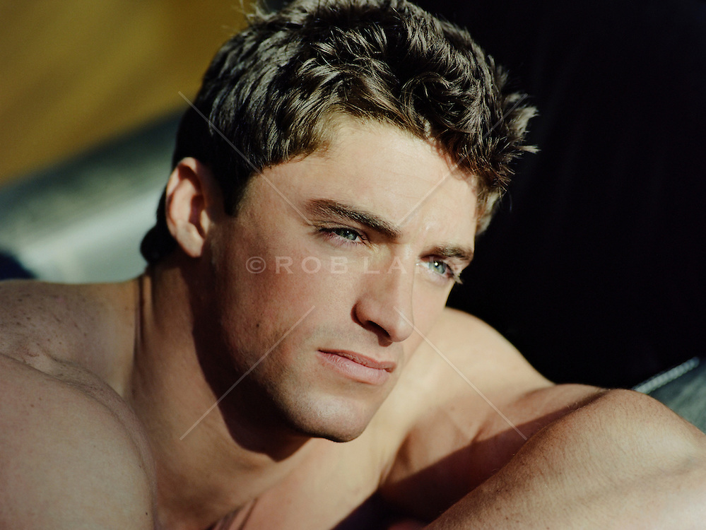 portrait of a handsome chiseled man with blue eyes and brown hair