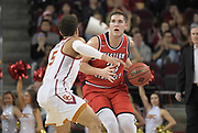 Western Kentucky Hilltoppers forward Justin Johnson (23) is defended by Southern California Trojans guard Derryck Thornton (5) during an NCAA college basketball game in the second round of the NIT tournament in Los Angeles, Monday, Mar 19, 2018. WKU defeated USC 79-75.
