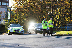 © Licensed to London News Pictures. 27/10/2019. Salford, UK. Police officers survey the scene . A car lies on its side on a pedestrian walkway at the Pendleton Roundabout on Broad Street in Salford . Members of the public pulled a man and a woman from the wreckage after a BMW car crashed through a barrier and landed on a pedestrian walkway below . Their condition is unknown and police , paramedics and fire crews are at the scene . Photo credit: Joel Goodman/LNP