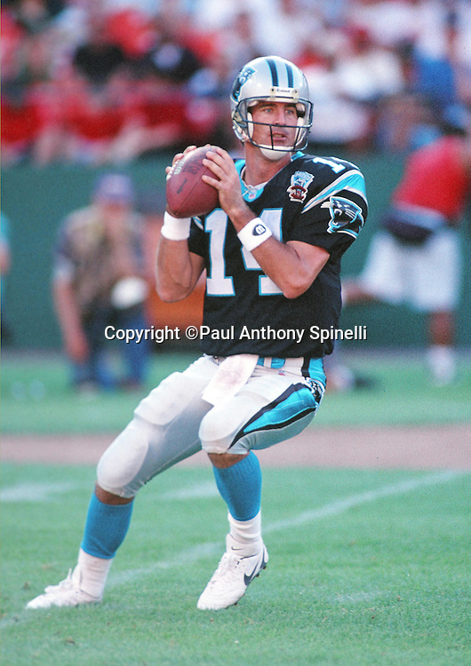 Carolina Panthers quarterback Frank Reich (14) drops back to pass during the NFL preseason football game against the San Francisco 49ers on Aug. 19, 1995 in San Francisco. The 49ers won the game 17-10. (©Paul Anthony Spinelli)