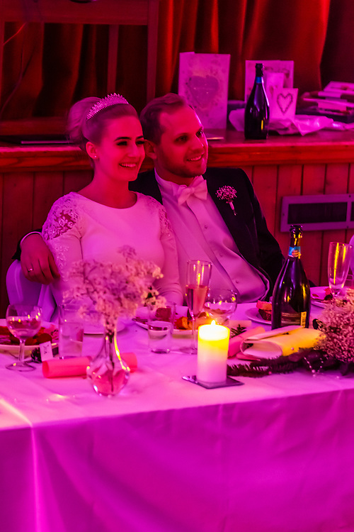 A Norwegian bride and groom during their reception after their winter wedding in Trysil, Norway.