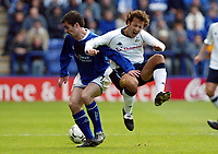 Photograph: Scott Heavey.<br />Leicester City v Tottenham Hotspur. 19/10/2003. FA Barclaycard Premiership.<br />Keith Gillespie goes through Mauricio Taricco with a strong challenge.