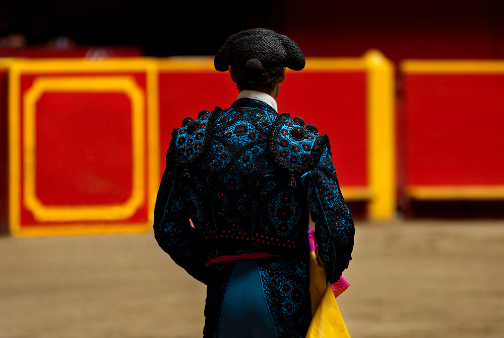 At La Macarena Stadium a matador waits for the arrival of the bull.  The Festival of the Bulls is a month long celebration of bullfighting in Medellin.