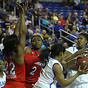 Delaware Guard Courtni Green (2) pulls down her own rebound as St. John's Guard Eugeneia McPherson (22) and Forward Amber Thompson (2) defends in the first half of a NCAA regular season non-conference game between Delaware (CAA) and St. John's (Big East) Monday, Dec 30, 2013 at The Bob Carpenter Sports Convocation Center in Newark Delaware.