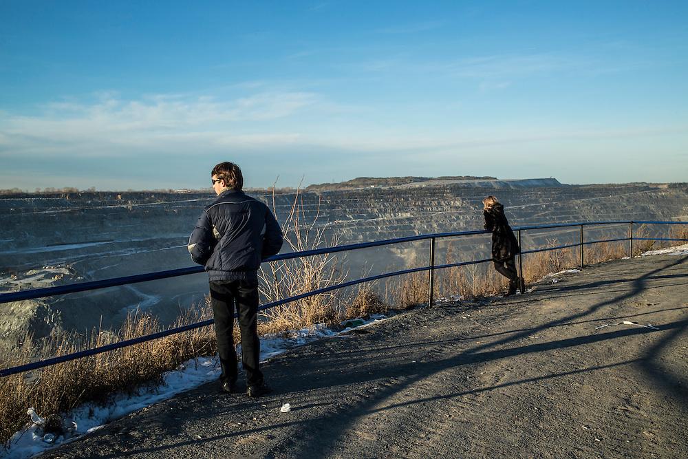 Nikolai Ross, left, looks at the Uralasbest asbestos mine on Sunday, November 24, 2013 in Asbest, Russia.
