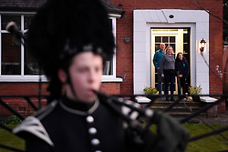 George Orchin (12), a piper in the Campbell College Pipe Band, plays Amazing Grace outside his neighbour's Jill Scott her husband Gordon and daughter Rececca's house in East Belfast, Northern Ireland, during a second Thursday night of 'Clap for our Carers' as people across the country showed their appreciation for all NHS workers who are helping to fight the coronavirus.